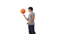 Man spinning a basketball on his finger Footage