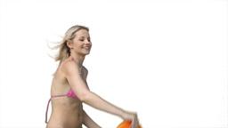 A woman playing Frisbee in her bikini Footage