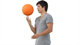 Man practising spinning a basketball Footage
