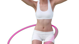 Close up of a woman using a hula hoop Footage
