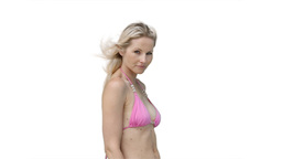 A woman in her pink bikini posing Stock Video Footage