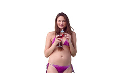 Woman in her purple bikini with a drink in her han Stock Video Footage
