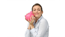 Business woman rubbing her piggybank Footage