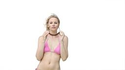 Woman wearing sunglasses and her bikini Footage
