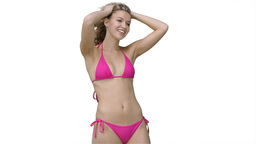 Woman in a pink bikini posing as the wind blows Stock Video Footage