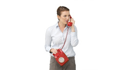 Woman talking on the red telephone Footage
