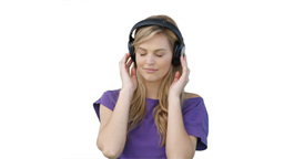 Woman listening to her music on headphones Stock Video Footage