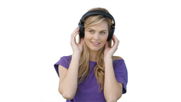 Woman listening to her music on headphones Footage