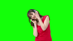 Woman listening using headphones to listen to musi Stock Video Footage