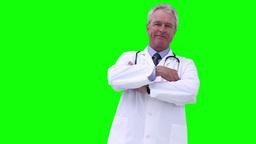 Doctor folding his arm while looking at the camera Footage