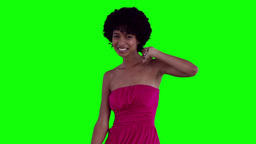 Woman dancing with her arm raised Footage
