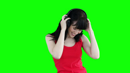 Woman dancing while listening to headphones Footage