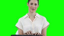 Businesswoman typing on a keyboard Footage