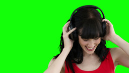 Woman wearing headphones while dancing Footage