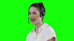 Woman talking while wearing a headset Footage