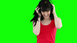 Woman happily dancing while listening to music Footage