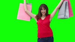 Woman raising shopping bags Stock Video Footage