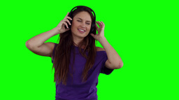 Woman dancing happily while wearing headphones Stock Video Footage