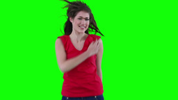 Woman feeling her hair as she is jumping Footage