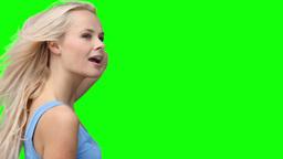 Blonde woman dancing energetically Footage