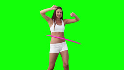 Woman happily spinning a hula hoop Footage