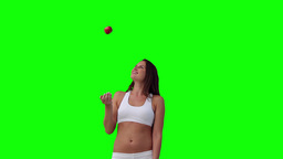 Woman throwing a ball before catching it Footage