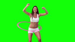 Woman spinning a hula hoop with her arms spread Stock Video Footage
