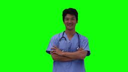 Nurse walks in before crossing his arms Stock Video Footage