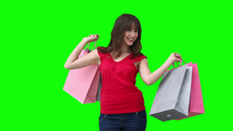 Woman talking across the screen while holding shop Footage