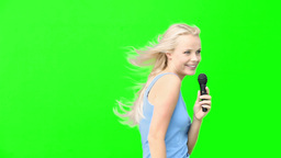 Blonde woman pointing and dancing while singing Footage
