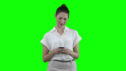 Woman texting on her cellphone before looking to h Stock Video Footage