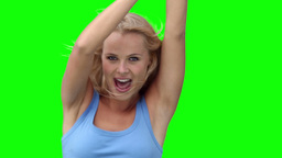 Blonde woman dancing to music Footage