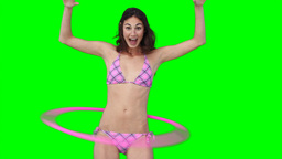 A woman playing with a hula hoop Stock Video Footage