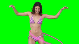 A woman playing with a hula hoop Footage