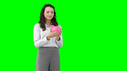 A woman holding a piggybank Stock Video Footage