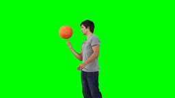 A man spins a basketball on his finger Footage