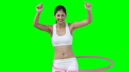 A woman enjoys using a hula hoop Stock Video Footage