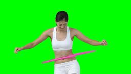 A woman enjoys using a hula hoop Footage