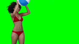 A smiling woman throws a beachball off screen Stock Video Footage