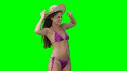 A woman wearing a hat as it is blown away Footage