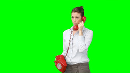A woman on the telephone having a serious discussi Footage