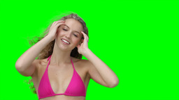A woman stroking her hair as the wind blows Footage