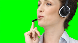 Close up of a woman on a headset Footage