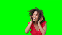 A woman listening to music on headphones Footage