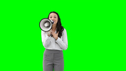 A woman using a megaphone to talk Footage