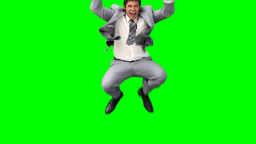 A business man jumps up and down in joy Stock Video Footage
