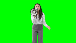 A woman shouting angrily on a megaphone Footage