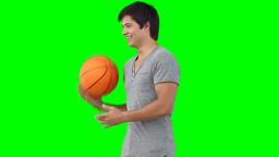 A man spinning a basketball on his hand Footage