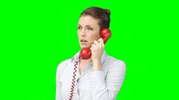 A woman talks on the telephone Footage