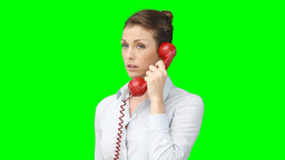 A woman talks on the telephone Stock Video Footage